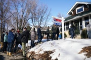 Home shoppers and their real estate agents waited March 4 to view a home for sale near Como Park in St. Paul.
