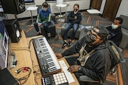 Mickey Breeze (center) worked with students Will Riordan 11, left ,Nora Thul 11, and Alexander Williamson 12, to create music in a class at Powderhorn