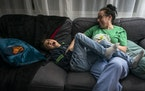 Pediatric critical care nurse Shannon Marchiando played with her son Marcos Palma-Marchiando, 8, after coming home from a 12-hour shift at Masonic Chi