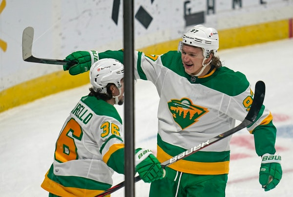 Kirill Kaprizov celebrated his third goal with Mats Zuccarello during the third period.