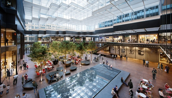 A revamped Crystal Court in the IDS Center will feature new seating and canopies of trees expected to grow 24 feet tall.