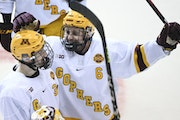 Among the Gophers' 20 wins this season was a 5-1 home victory over Michigan State, celebrated by Ben Meyers and Mike Koster.