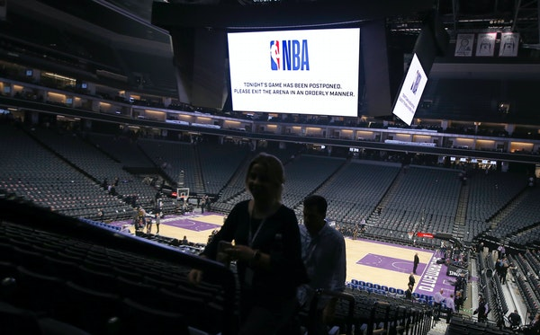 """Fans left the Golden 1 Center in Sacramento, Calif., after the Pelicans-Kings game on March 11, 2020 was postponed at the last minute over an """"abund"""