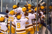 Gophers men's hockey players mobbed one another after winning in overtime vs. Michigan State on Sunday in the Big Ten tournament quarterfinals.