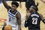 Timberwolves rookie Anthony Edwards reacts after dunking over Portland's Robert Covington in the fourth quarter Sunday