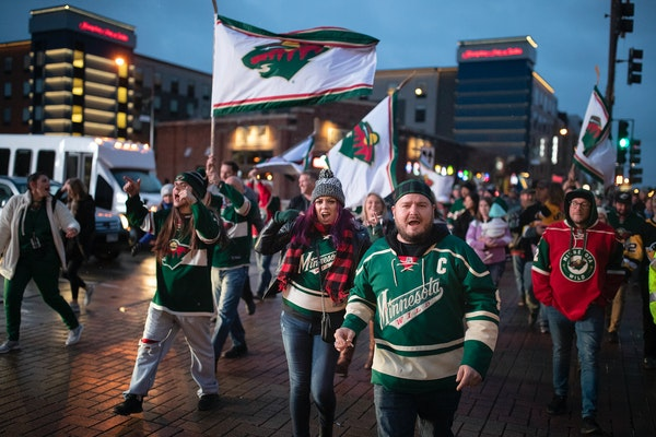 Minnesota Wild fans marched from Tom Reid's Hockey City Pub to Xcel Energy Center for the home opener.] Jerry Holt • Jerry.holt@startribune.com