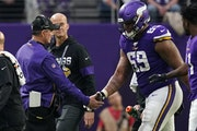 Vikings coach Mike Zimmer and offensive tackle Rashod Hill.