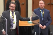 In this image from video, defense attorney Eric Nelson and defendant Derek Chauvin spoke before jury selection on Monday, March 15.
