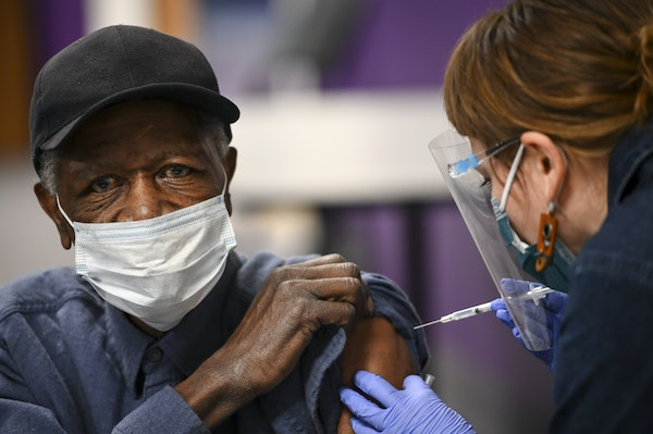 M Health Fairview nurse Nicole Parr administered a dose of the Pfizer BioNTech COVID-19 vaccine on Feb. 19 to James Wells, 73, of Minneapolis, at Shil