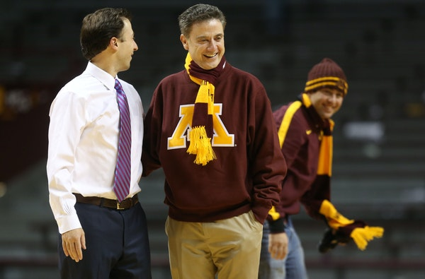 Richard Pitino spent some time with his father, Richard, after a Gophers game in 2013 at Williams Arena.