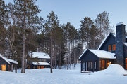 Two lifelong friends wanted a shared retreat to enjoy together and with their individual families, and they built it to feel like a modest Minnesota r