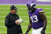Vikings coach Mike Zimmer with defensive tackle Shamar Stephen.
