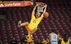 Former Gophers forward Jarvis Omersa (shown dunking against Loyola Marymount in December) announced Sunday he is transferring to St. Thomas.