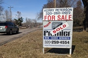 A house on Cooper Avenue South in St. Cloud is marked as sold on Thursday, March 11, 2021.