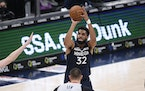 Wolves center Karl-Anthony Towns (shown against the Wizards in February) is shooting only 26% from three-point range over his past six games. He's b