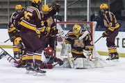 Gophers goalie Jack LaFontaine made 46 saves and got plenty of help from teammates in the 6-4 win over Wisconsin.