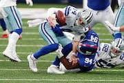 Giants nose tackle Dalvin Tomlinson sacked  Cowboys quarterback Andy Dalton during a Week 17 game.