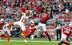 Patrick Peterson intercepts a pass in the end zone intended for Browns wide receiver Odell Beckham during a game in December, 2019. Peterson has agree
