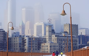 The Minneapolis skyline was locked in an hazy shroud in February 2021, as seen from the Stone Arch Bridge.