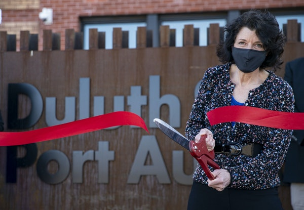 Deb DeLuca, the executive director of the Duluth Port Authority cut a ribbon to officially open its new headquarters on Thursday, March 18, 2021.