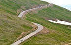 Cars traveled along Trail Ridge Road, a scenic byway in Colorado.