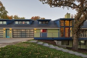 """This lake home in Okoboji, Iowa, was redesigned by Rehkamp Larson Architects for clients who love vibrant color. """"The goal was to create a joyful ho"""