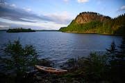 The sun illuminated a dramatic palisade on South Fowl Lake Friday night near the dam.