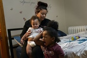 Keyana Johnson, with children Prodigy and Stephon, had to leave foster care when she was 21 and pregnant.