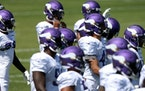 Minnesota Vikings players warmed up before the start of practice.