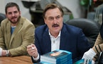 """Mike Lindell signed a fresh shipment of his book """"What Are the Odds? From Crack Addict to CEO"""" at the Shakopee factory of his MyPillow business in"""