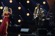 "Maren Morris, left, and John Mayer perform ""The Bones"" at the 63rd Grammy Awards."