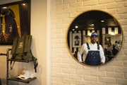 Houston White inside his barber/coffee shop/menswear showroom.
