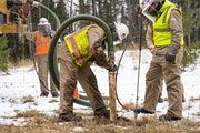 Enbridge contractors worked to identify an older Enbridge pipeline, Line 16, at one of the Line 3 work sites in Carlton, Minn., in December. Money spe