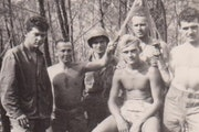 WILLIAM KNUPPEL JR. 1919-2013  Sgt. Bill Knuppel, seated and shirtless, joined platoon mates in showing off swords during World War II.  Knuppel, a na