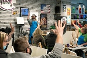 At a socially distanced painting class, Tara Tepley, the owner of the Paint Factory in Hutchinson, Minn., asked who had attended one of her classes be