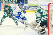 Minnetonka's Grace Sadura (7) gets off a shot for a third period goal agains Holy Family Saturday evening. Sadura added an assist in the Skippers'