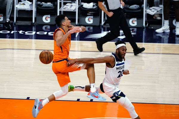 Wolves guard Josh Okogie knocked the ball away from Phoenix star Devin Booker during the second half Friday, when Okogie was tasked on slowing Booker