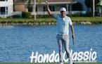 Matt Jones raised his ball after winning the Honda Classic on Sunday in Florida.
