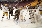 Gophers players, including captain Sammy Walker, left, celebrated a goal against Arizona State in January.