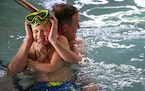 The Schroeder family, including patriarch John who took time in the pool with son Aiden, was among a wave of people vacationing along Minnesota's No