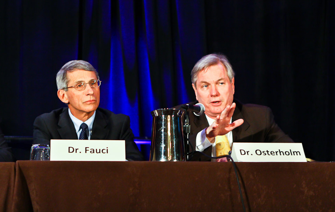 Dr. Anthony S. Fauci and Michael T. Osterholm in 2012 at the American Society for Microbiology Biodefense and Emerging Diseases research meeting.