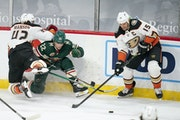 Ducks defenseman Josh Manson (42) got a piece Wild left wing Kevin Fiala (22) while attempting to check him in the third period, leaving the loose puc
