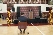 New Gophers men's basketball coach Ben Johnson listened to athletic director Mark Coyle speak at Tuesday's press conference.