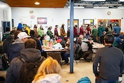 FILE-People line up for free lunch at CHUM Food Shelf in Duluth, MN on March 17, 2020 at the beginning of the pandemic. Now the group is planning to b