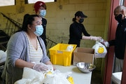 Kao Yong Yang distributed portioned meals to those in need Tuesday evening at Holy Rosary Catholic Church in south Minneapolis.