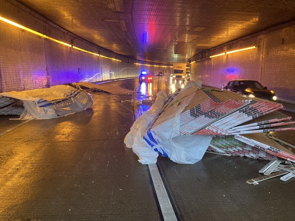 Drywall that fell off a semitrailer truck blocked lanes on eastbound I-94 inside the Lowry Hill Tunnel in Minneapolis.
