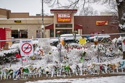 A dusting of snow coats the makeshift memorial for those who lost their lives in the mass shooting at King Soopers grocery store in Boulder, Colo.