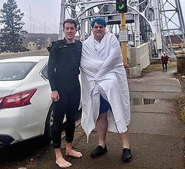 Darby Voeks, left, with the 29-year-old man he pulled out of frigid Lake Superior waters near the Duluth ship canal on Wednesday.