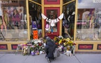Flowers lie outside the store owned by one of the 10 victims in the mass shooting in Boulder, Colo.