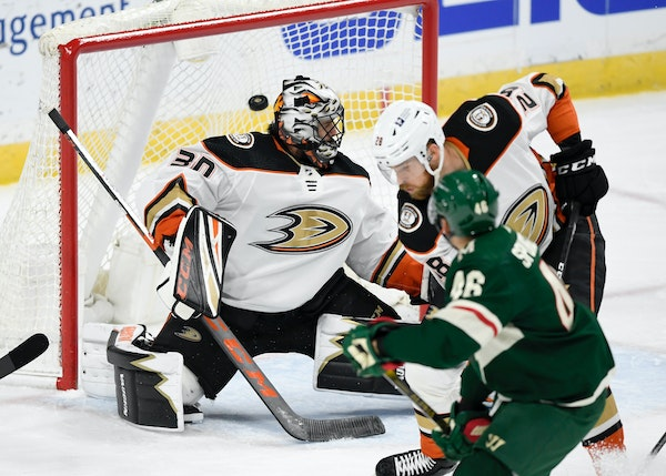 Minnesota Wild's Jared Spurgeon (46) watches as the his goal gets by Anaheim Ducks goaltender Ryan Miller (30) and Jani Hakanpaa (28), of Finland, d